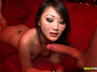 Slim chinese damsel in knee highs takes wood from the back in public